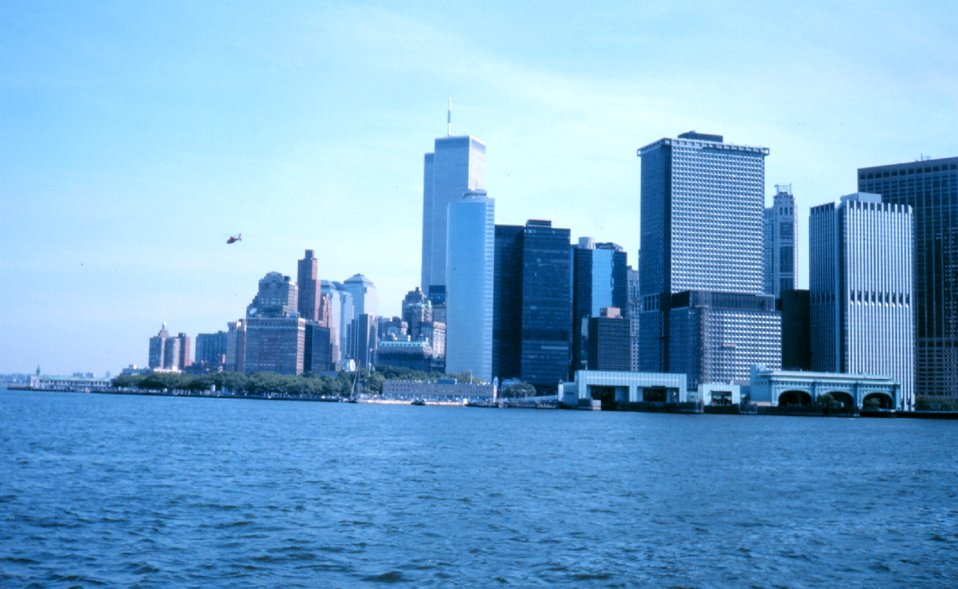 The World Trade Center and part of the New York skyline as seen from the Governor's Island Ferry.  The ferry terminals are in the right lower center of the photo.