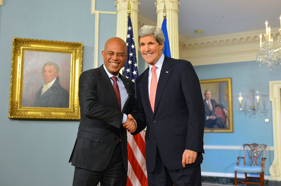 Secretary Kerry Shakes Hands With Haitian President Martelly