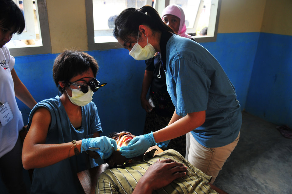 Sussi Yamaguchi Examines a Local Indonesian Patient