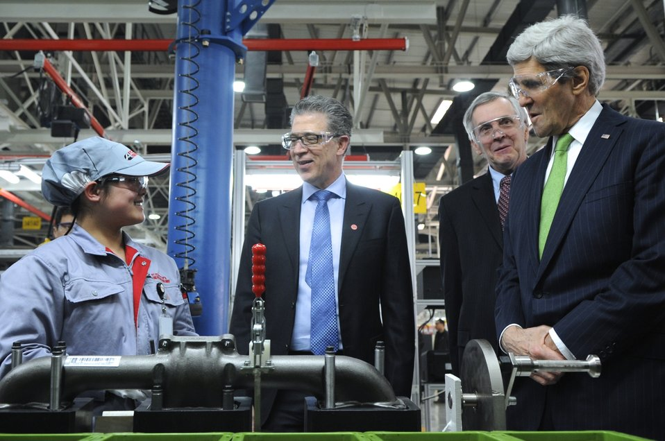 Secretary Kerry Chats With Worker on Engine Assembly Line