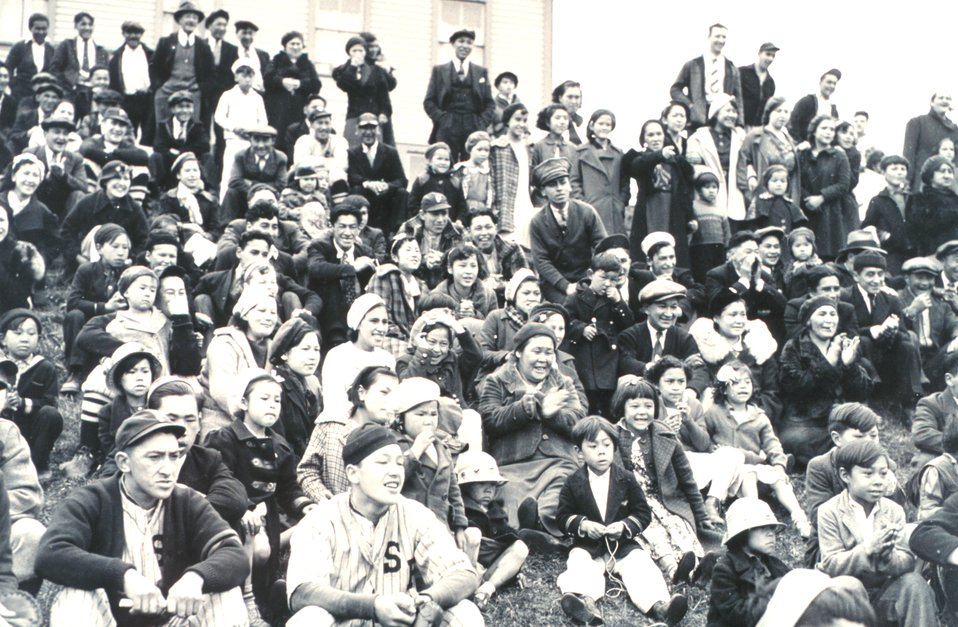 Part of the crowd celebrating the 4th of July at St. Paul.  A number of representatives of the local baseball team are dressed for a game.  F&WS 10,020.
