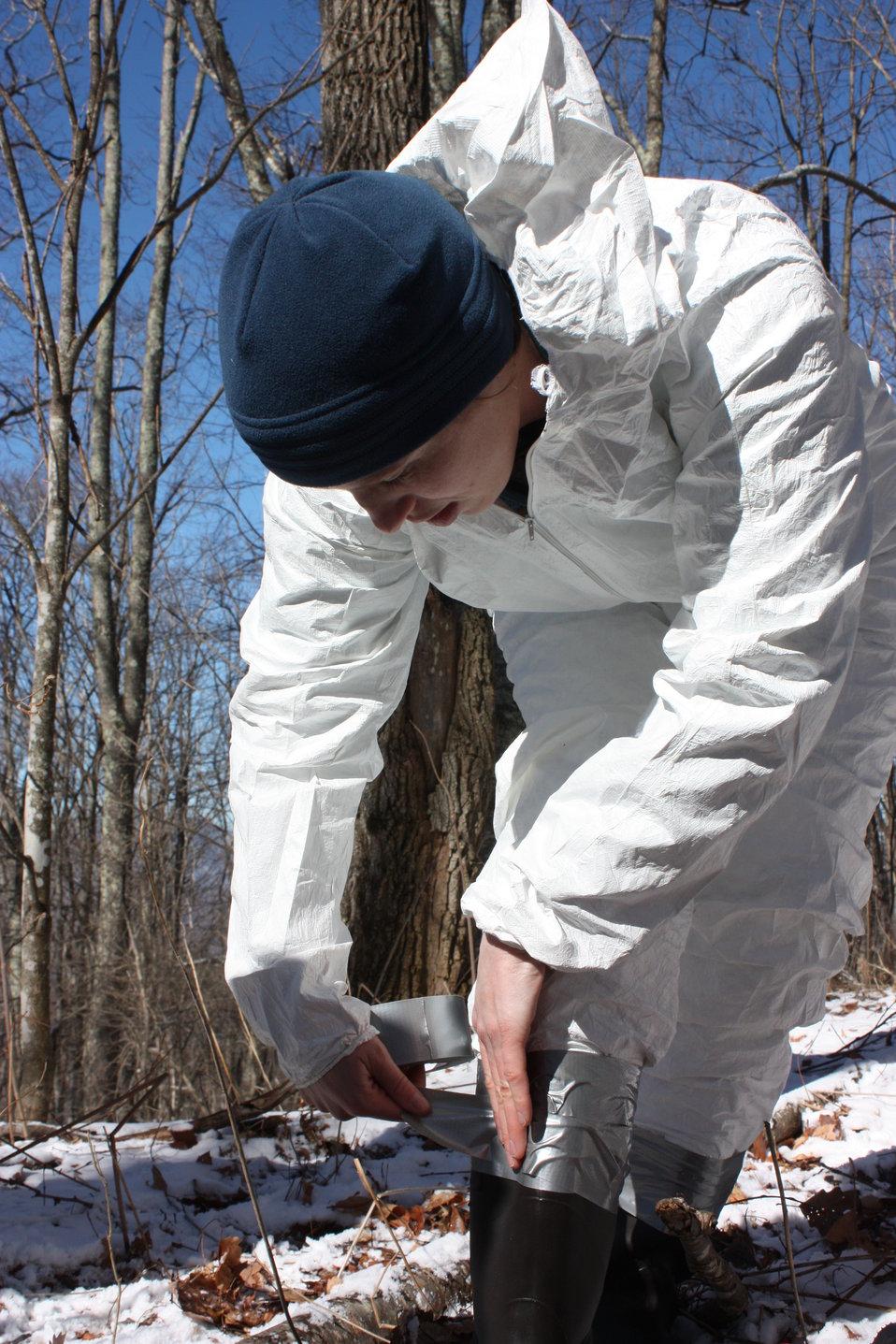 NCWRC biologist Cordie Diggins taping boot