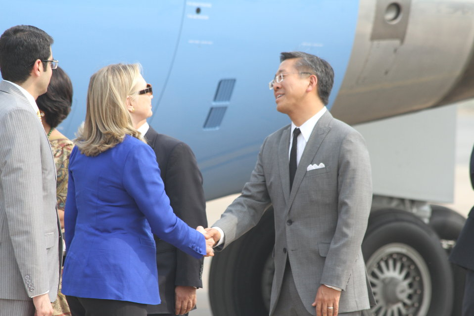 Secretary Clinton Is Greeted By Deputy Chief of Mission Lu