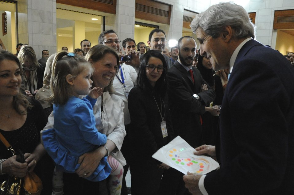 Secretary Kerry Admires 'S' Drawing Presented to Him By Daughter of Embassy Algiers Staffer