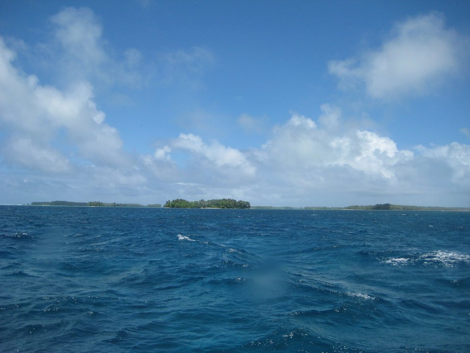 Palmyra Island seen looking astern from the NOAA Ship Hi'ialakai as it proceeds to its next project area.