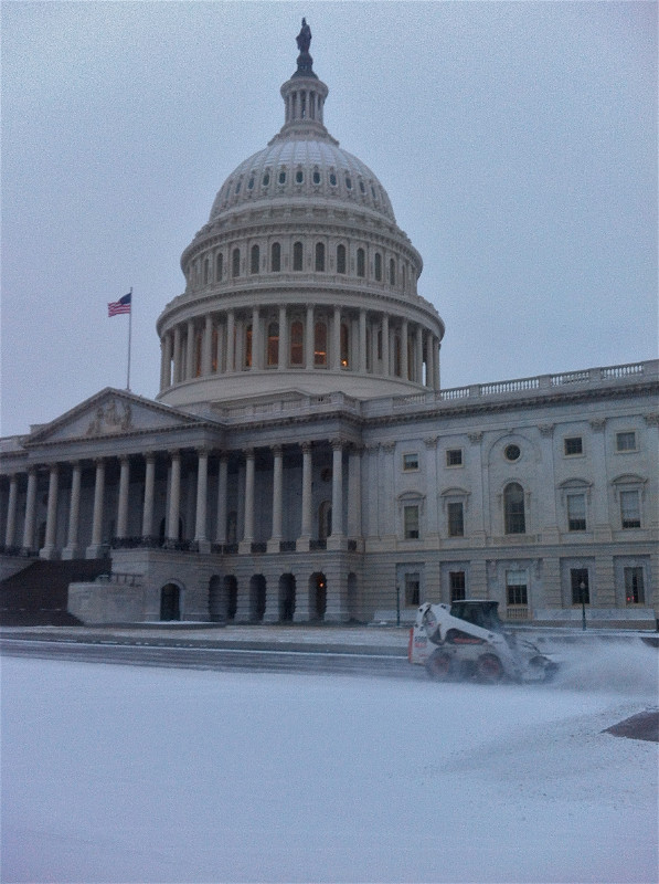 AOC staff at work clearing snow around Capitol