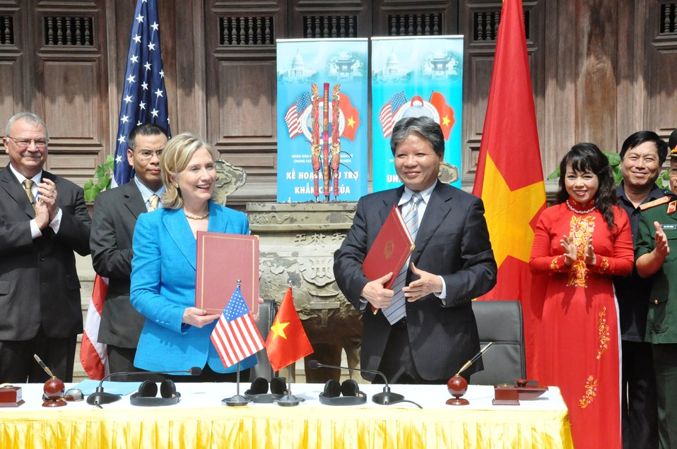 Secretary Clinton and Vietnamese Justice Minister Ha Hung Cuong Smile After Signing a Memorandum of Understanding