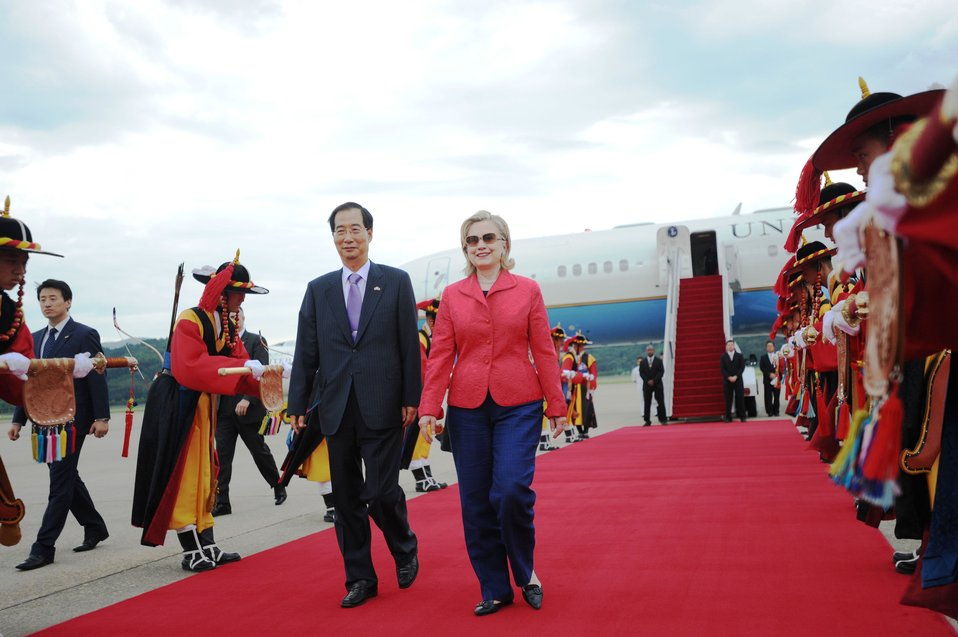 Secretary Clinton Is Escorted By Republic of Korea Ambassador to the U.S. Han Duck-soo