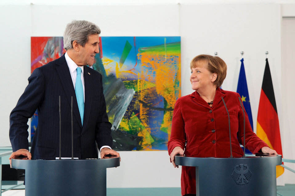 German Chancellor Merkel, Secretary Kerry Exchange Smiles During Press Statements