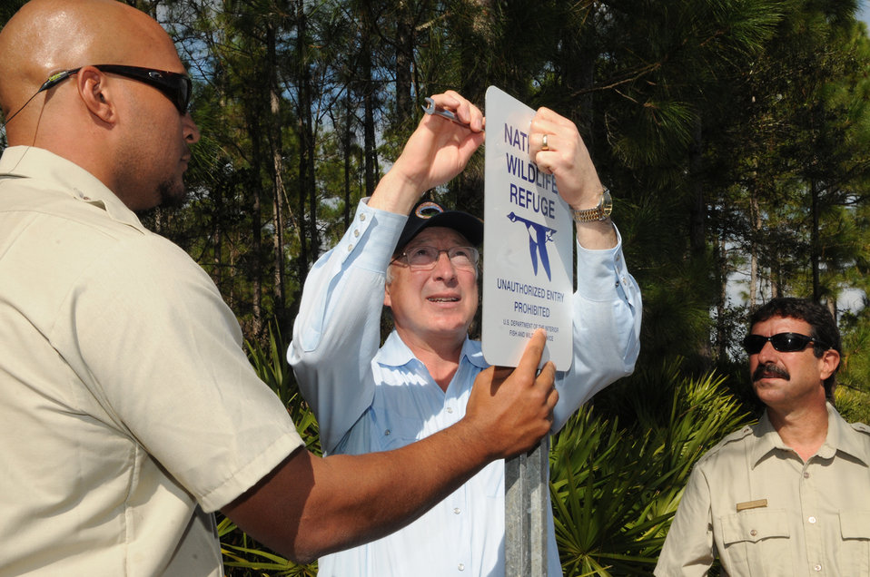 Secretary Ken Salazar and Keenan Adams Post Sign for Refuge