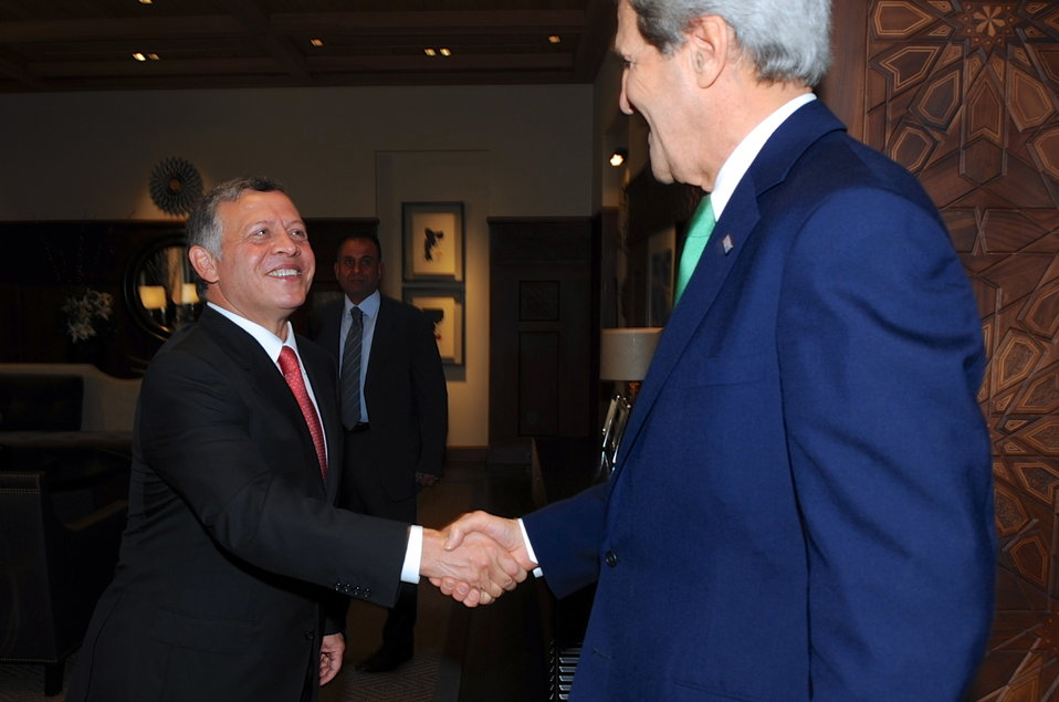 Secretary Kerry Is Greeted by Jordanian King Abdullah II in Amman