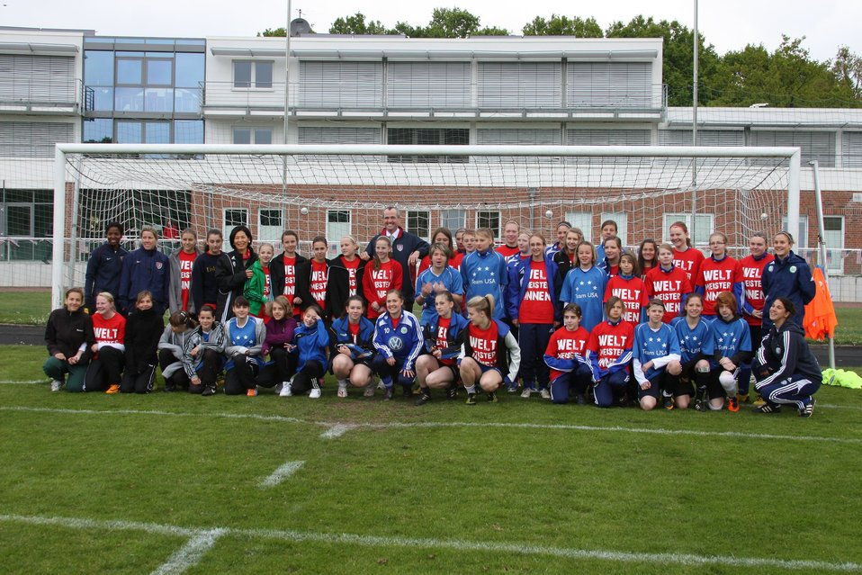Ambassador Murphy Poses With Local School Teams