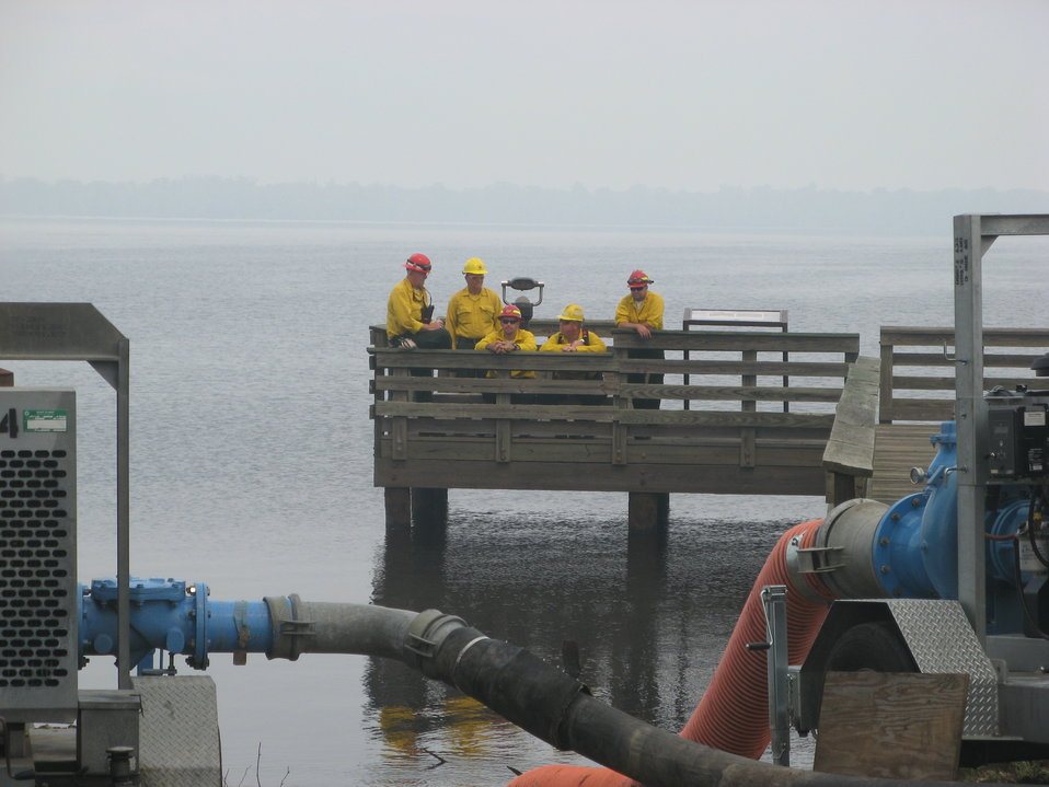 Firefighters on Lake Drummond