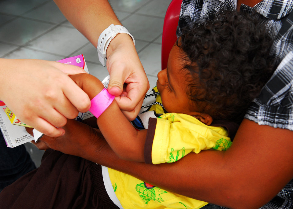 A Child's Bracelet Is Removed After Receiving Medication
