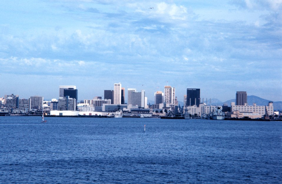 View of a naval facility.  San Diego before changing skyline with new construction.