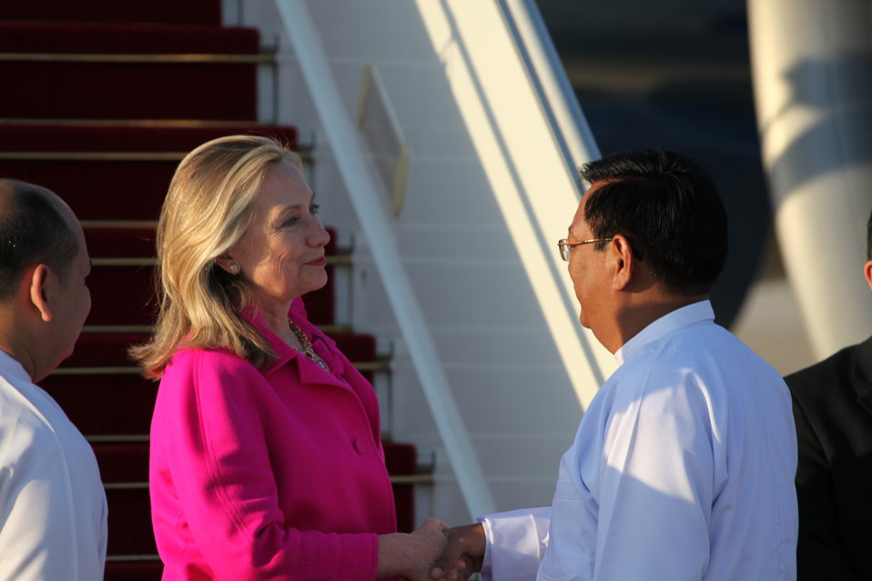 Secretary Clinton Is Greeted By Burmese Deputy Foreign Minister Dr. Myo Myint