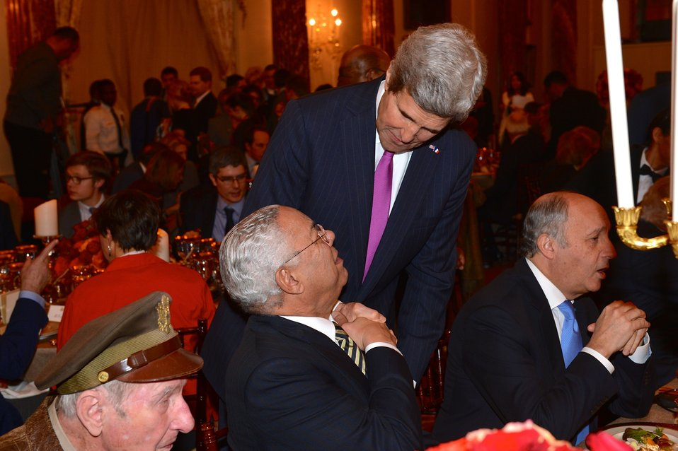 Secretary Kerry Shakes Hands With Former Secretary Powell