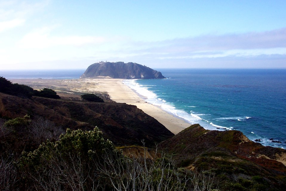 Looking down a pristine beach toward Point Sur.