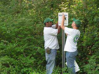 YCC putting up boundary sign