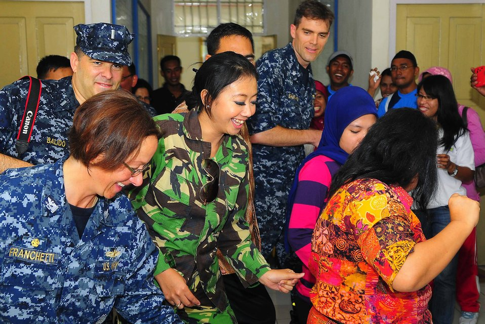 Popular Indonesian Television Personality Astrid Performs an Indonesian Dance With PP 2010 Commander Capt. Franchetti