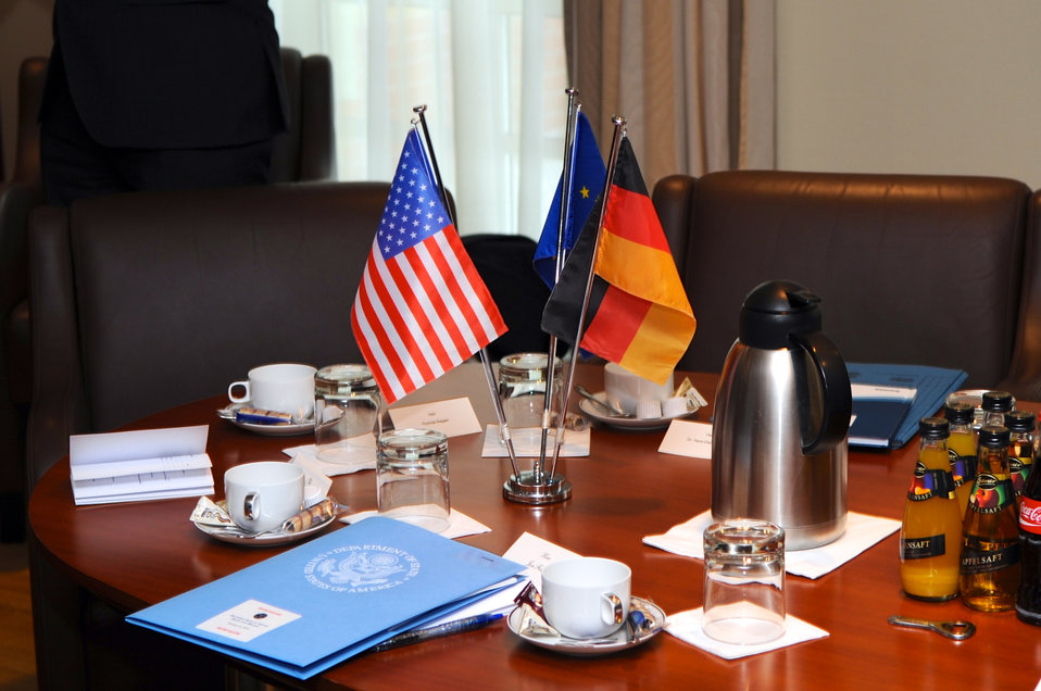 German, U.S., and E.C. Flags Adorn Berlin Meeting Table