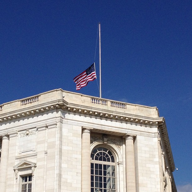 Blue skies and flags at half-staff this afternoon on Capitol Hill.