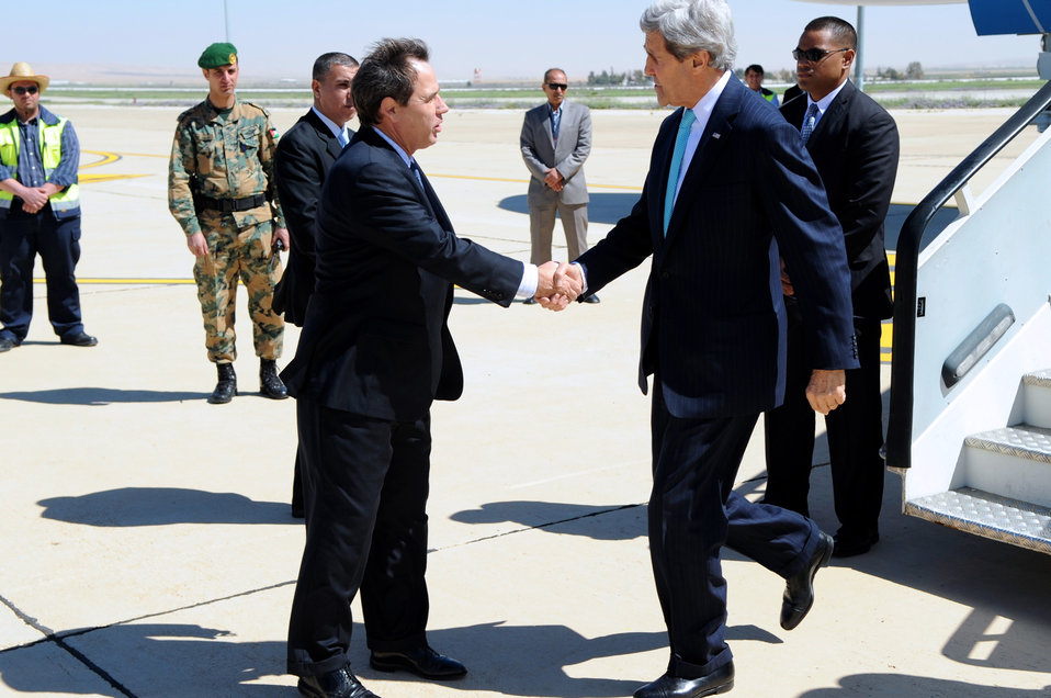Secretary Kerry is Greeted by Ambassador Jones Upon Arrival in Amman