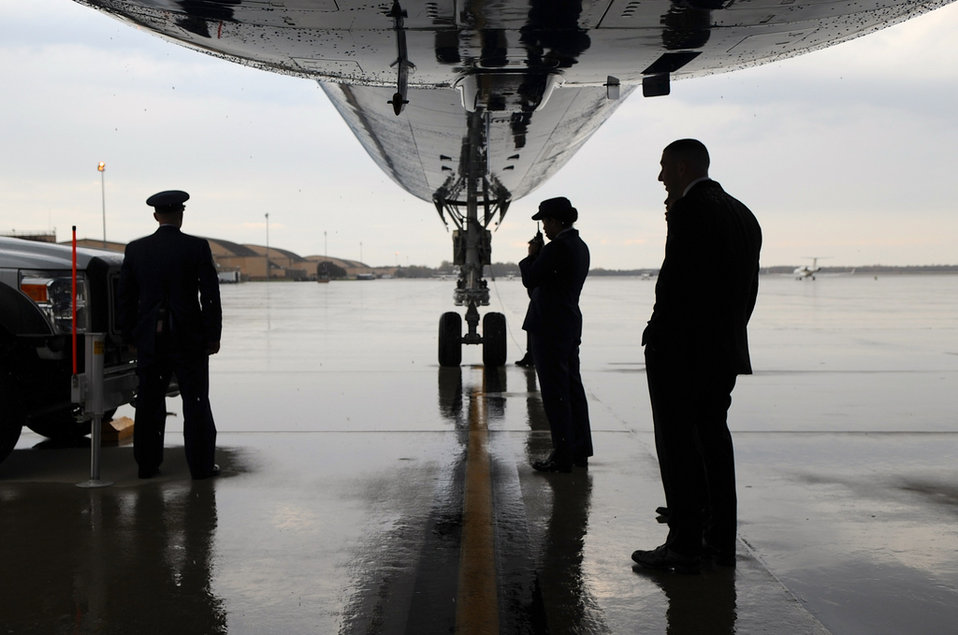Air Force Ground Crew Keeps Dry Awaiting Secretary Kerry
