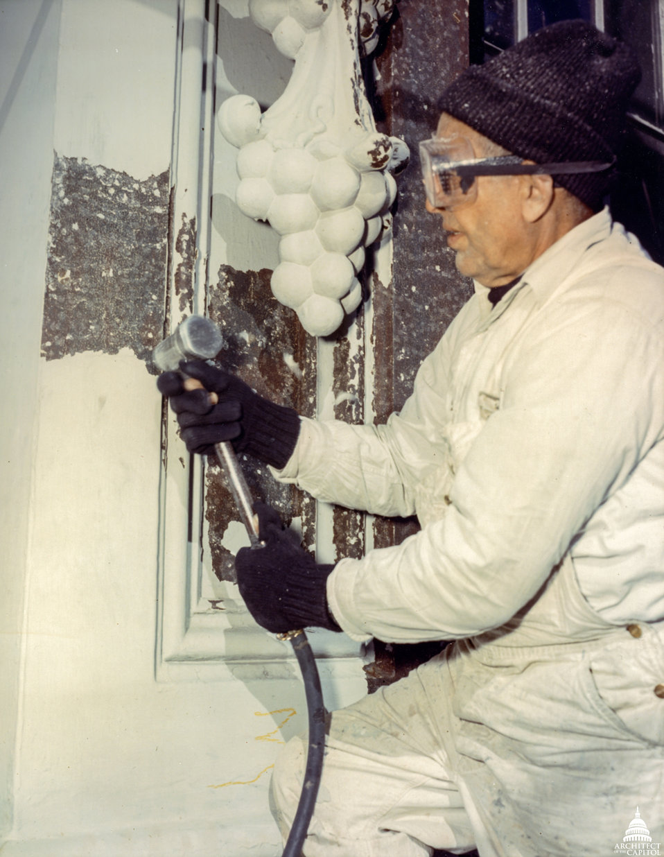 Workman conducting repairs on Dome 1960