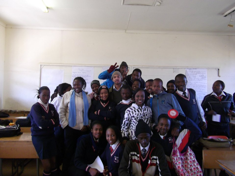 Pickering Fellow Roberts and South African Students Smile for a Photo