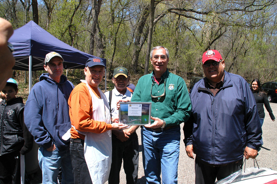 Longtime Volunteer of Kid's Fishing Day, Bob Jackson, Recieves Plaque of Appreciation from Regional Director Tom Melius