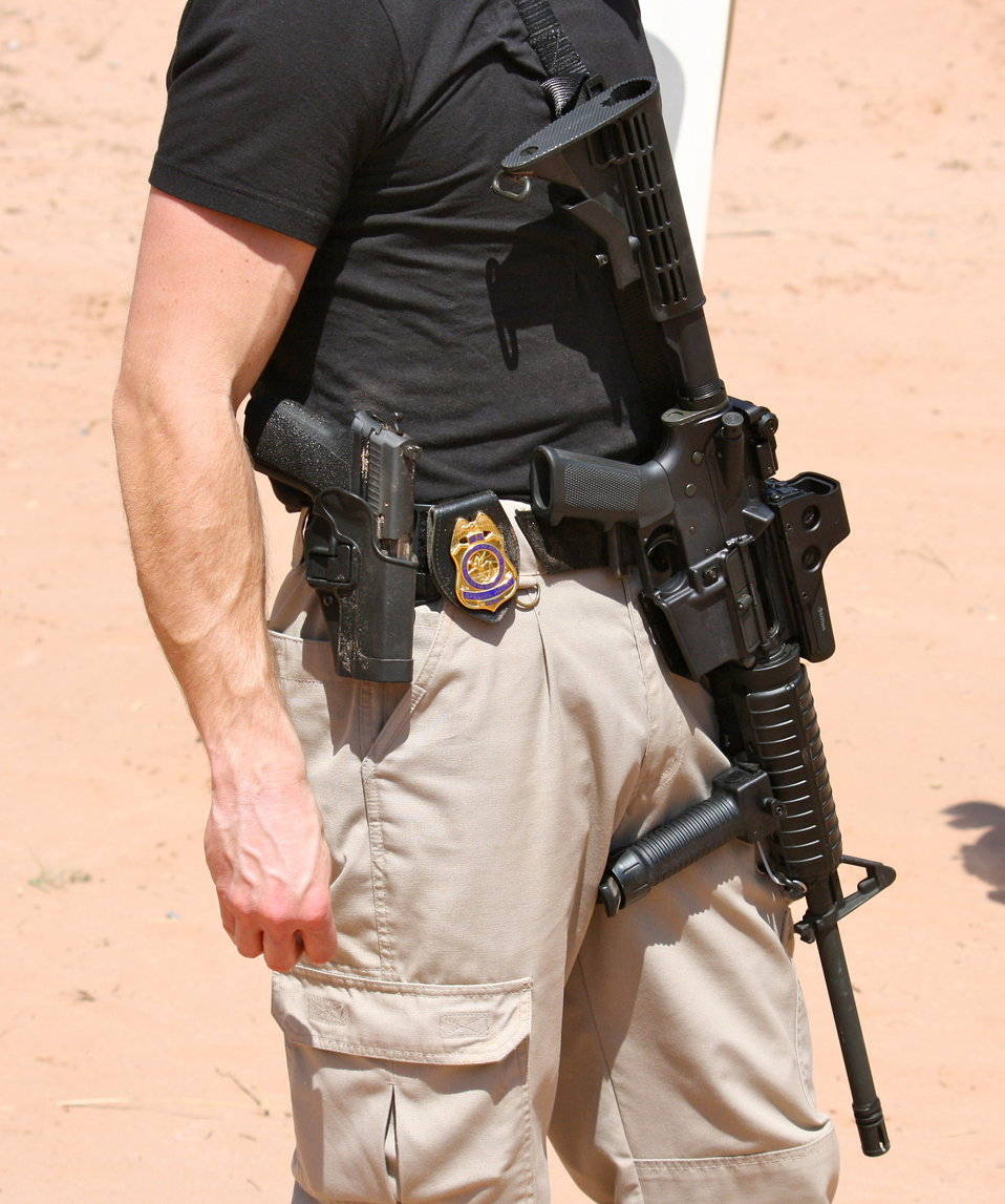 Special Agent with Sidearm, AR-15 and Badge
