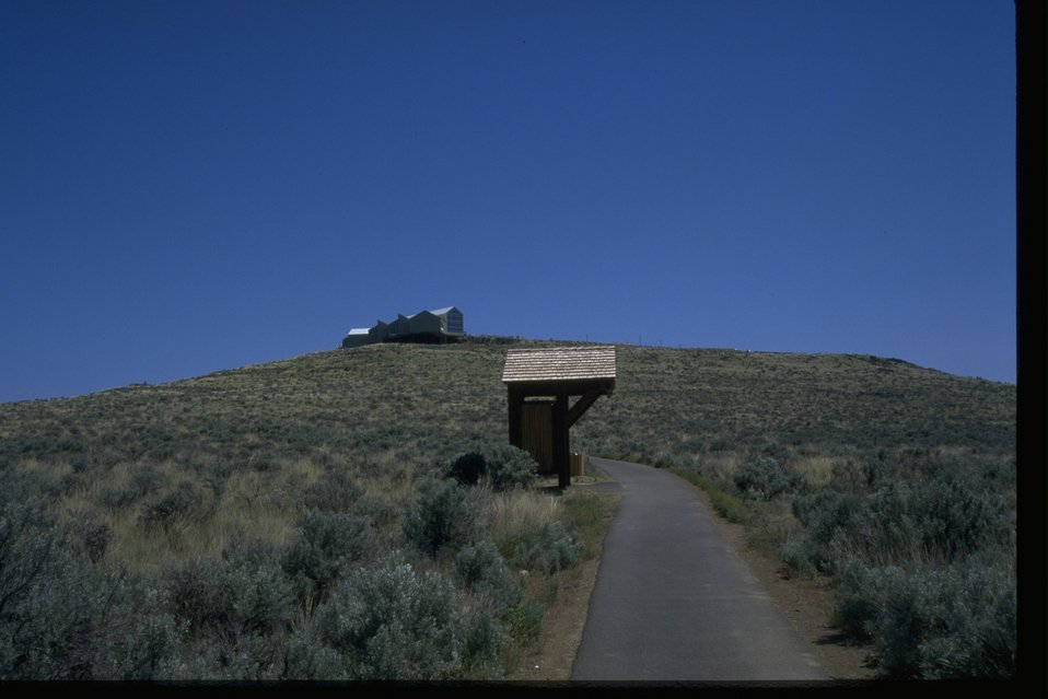 Distant view of the National Historic Oregon Trail Interpretive Center from a hiking trail.