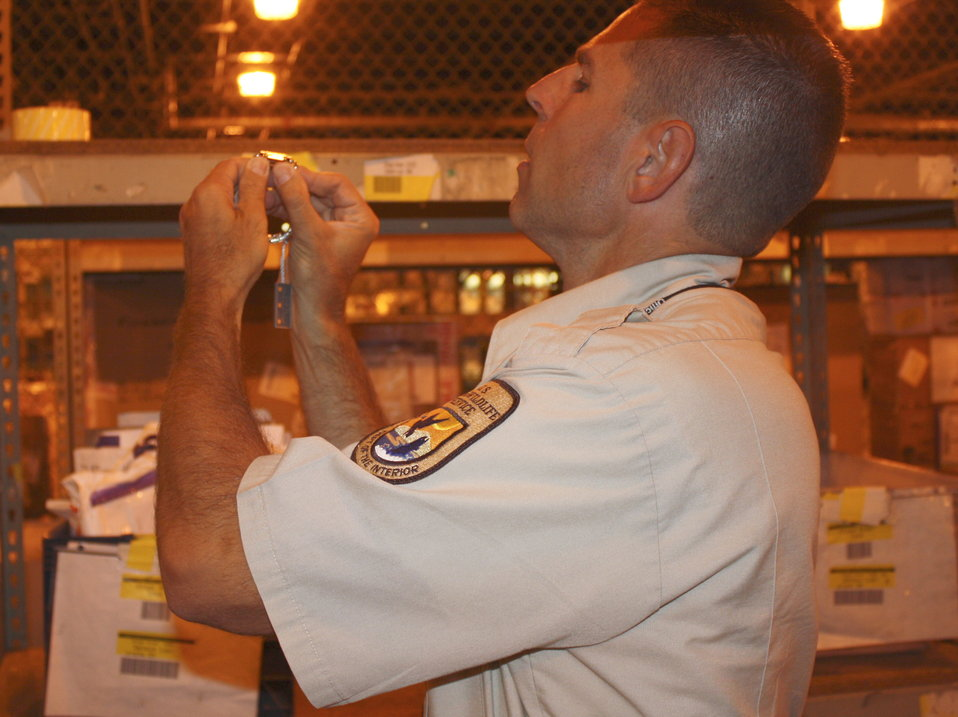 Inspector examines imported watch