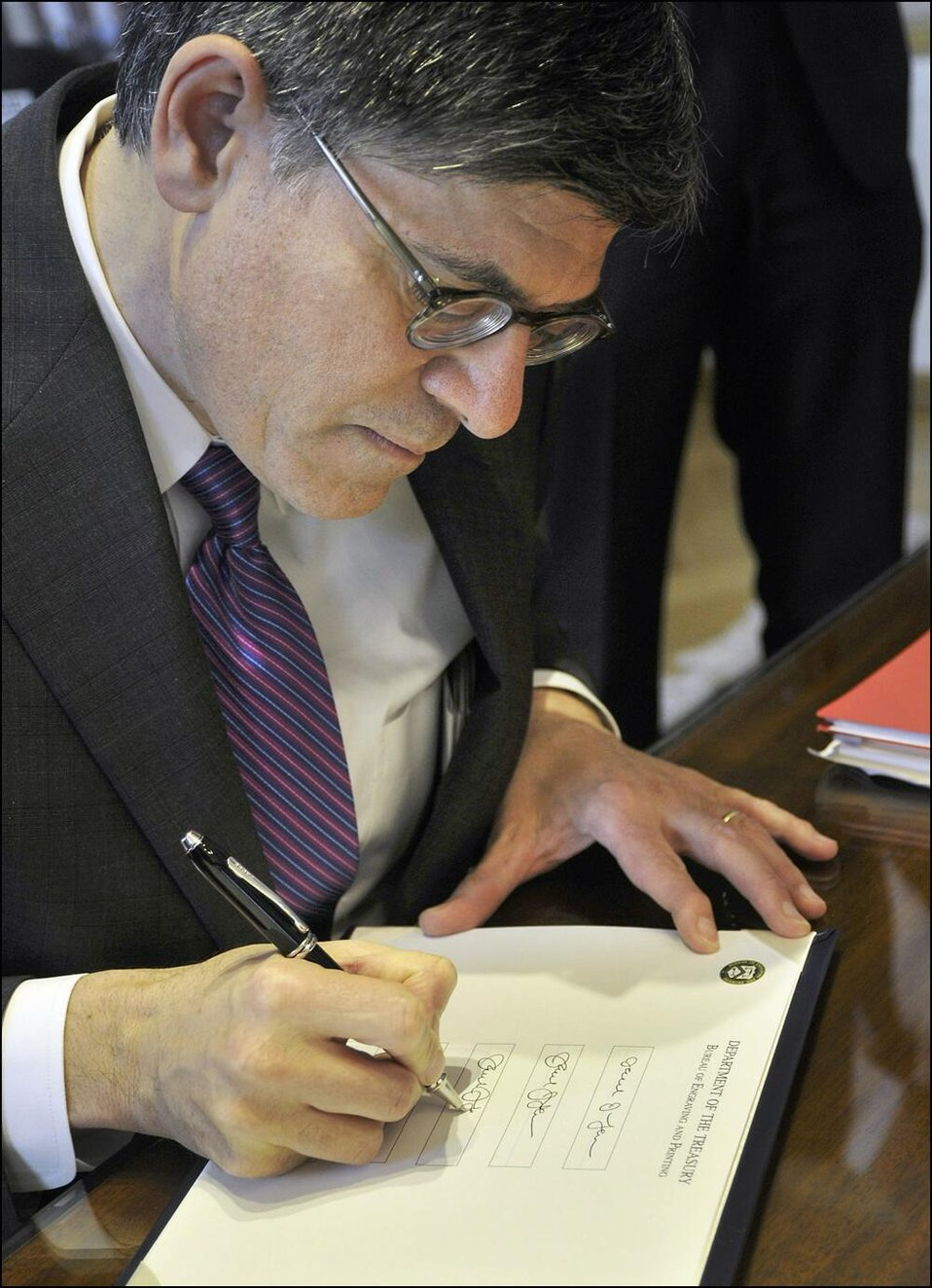 Secretary Lew provides his signature for printing on U.S. currency
