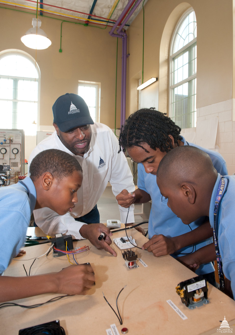 AOC Employee teaches high school students about electrical circuits