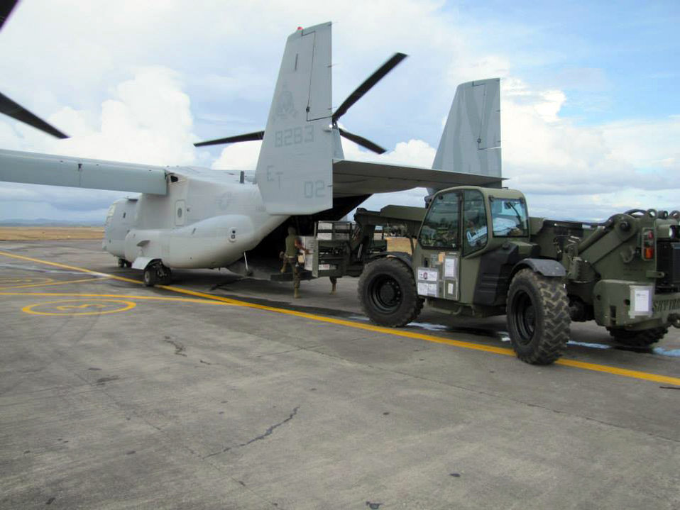 Relief Goods Are Offloaded From an Osprey