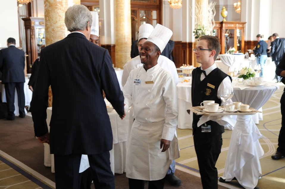 Secretary Kerry Greets Staff at Hotel Hosting Geneva II Conference