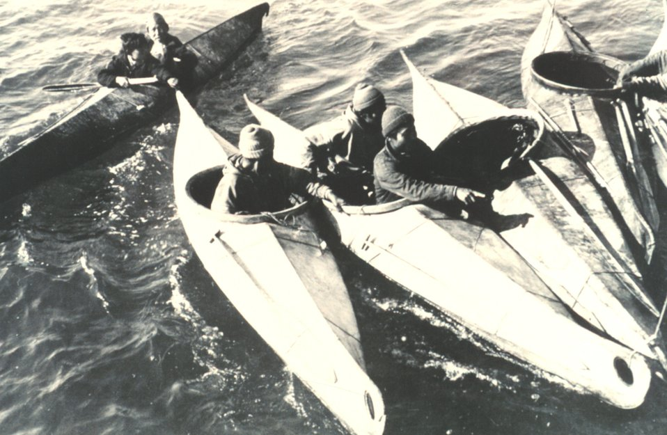 Eskimos congregating in their kayaks.  The kayaks are used for hunting and transportation.  F&WS B-51432.