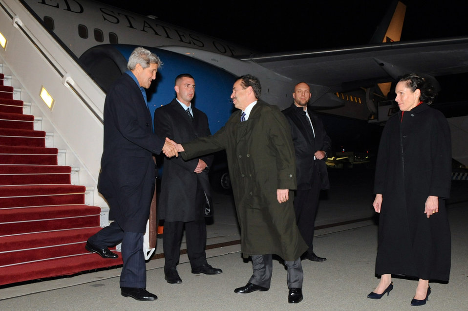 Secretary Kerry Is Greeted By Ambassador Mull and His Wife Upon Arriving in Warsaw, Poland
