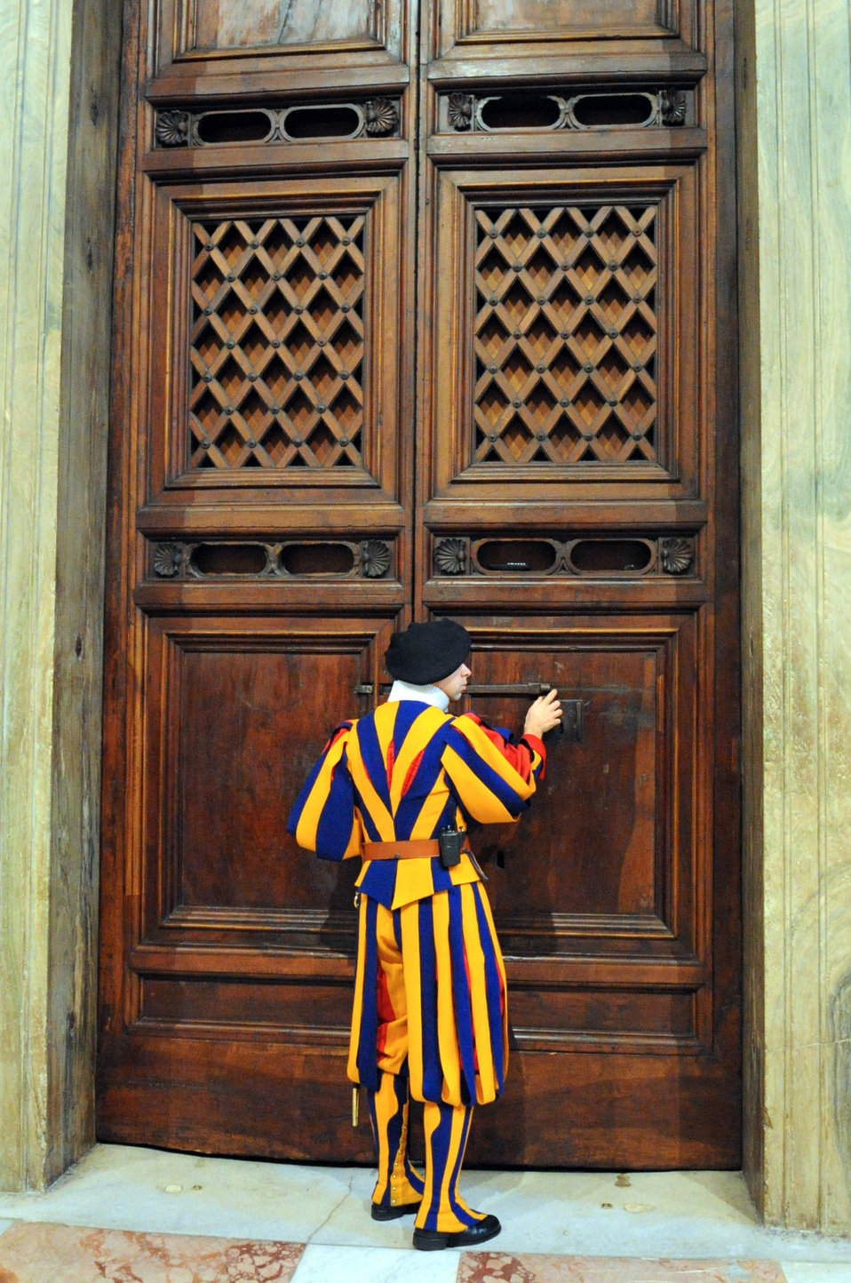 A Swiss Guard Unlocks the Door Outside of the Sistine Chapel for Secretary Kerry
