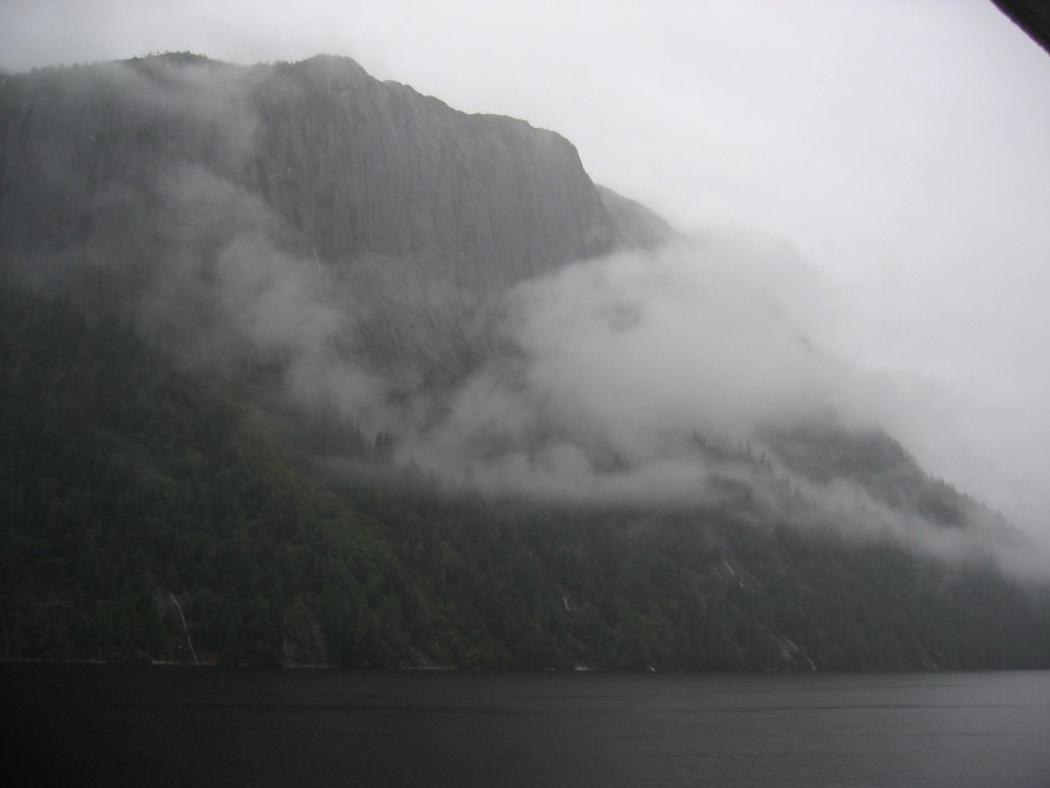 Precipitous cliffs, narrow waterways in the mist.