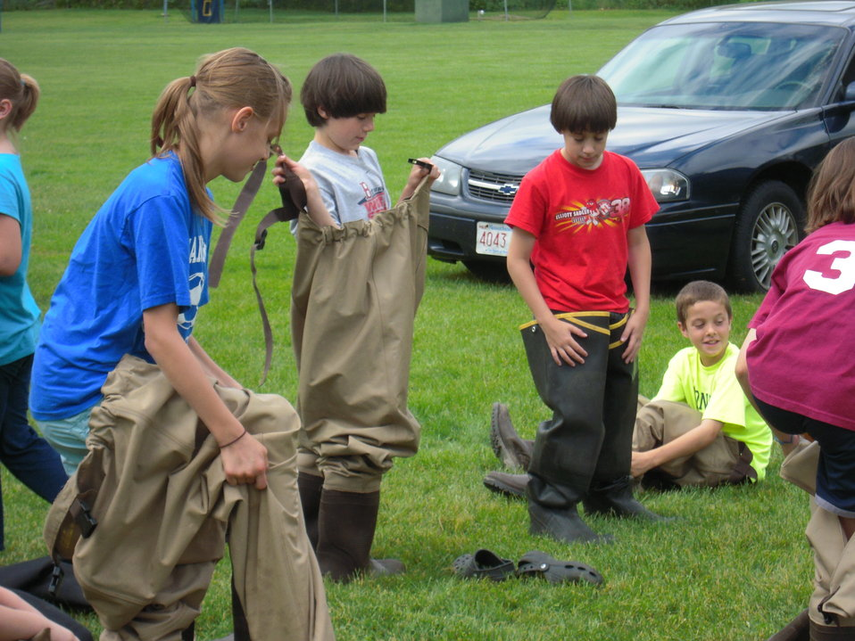 Putting on waders