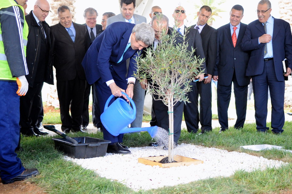 Secretary Kerry Waters Olive Tree Planted With Algerian Foreign Minister