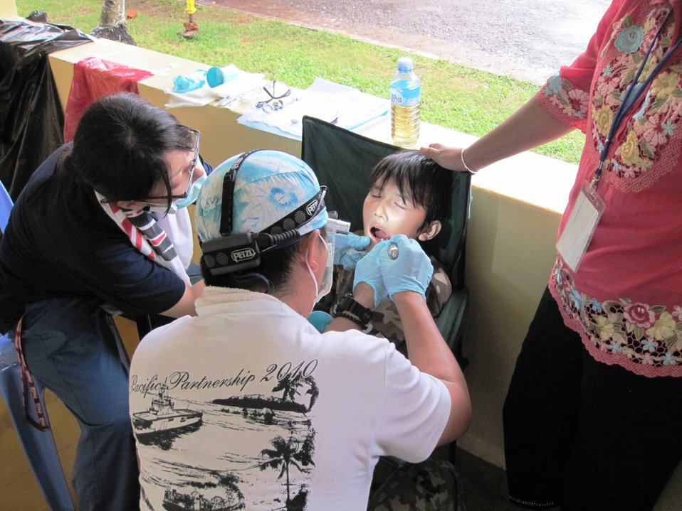 A Pacific Partnership 2010 Dentist Treats Cambodian Child