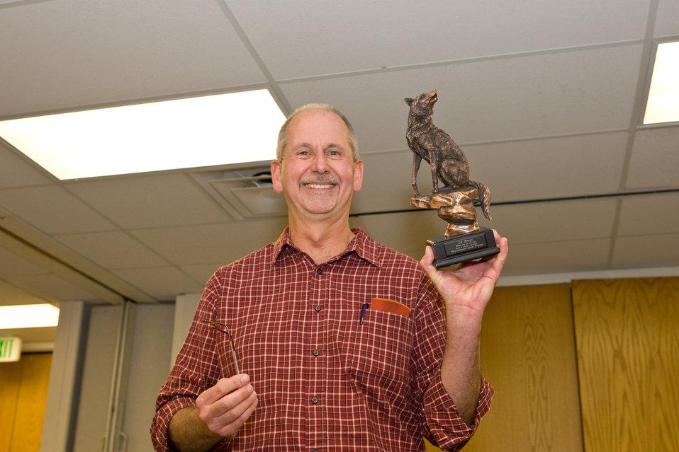 Ed Bangs Displays His Wolf Statue