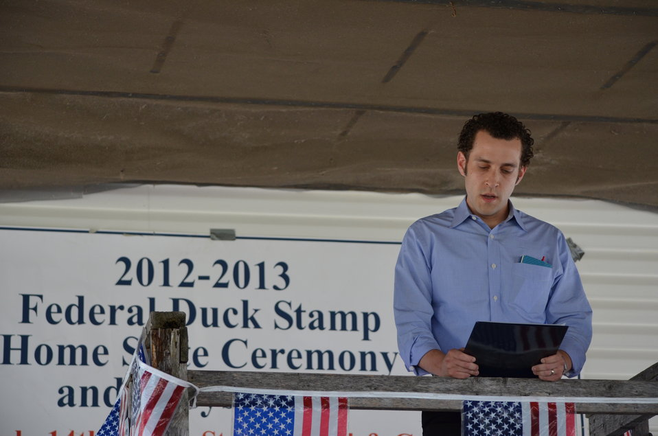 Adam Schiff, Outreach Director, reads a message on behalf of Senator Amy Klobuchar. Service photo.