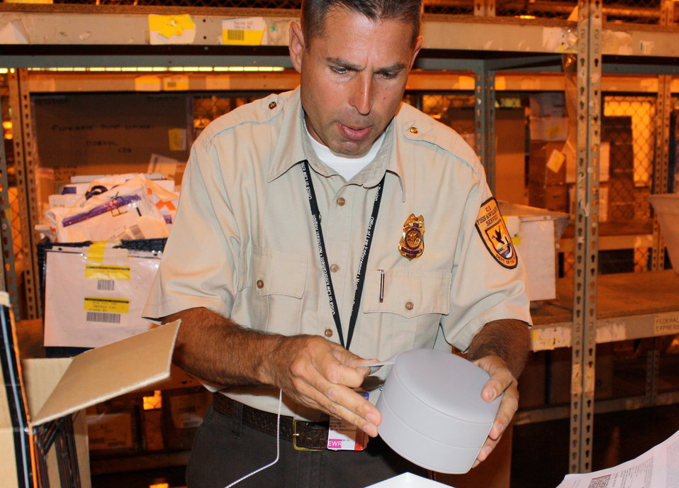 Inspector examines shipment at Newark International Airport