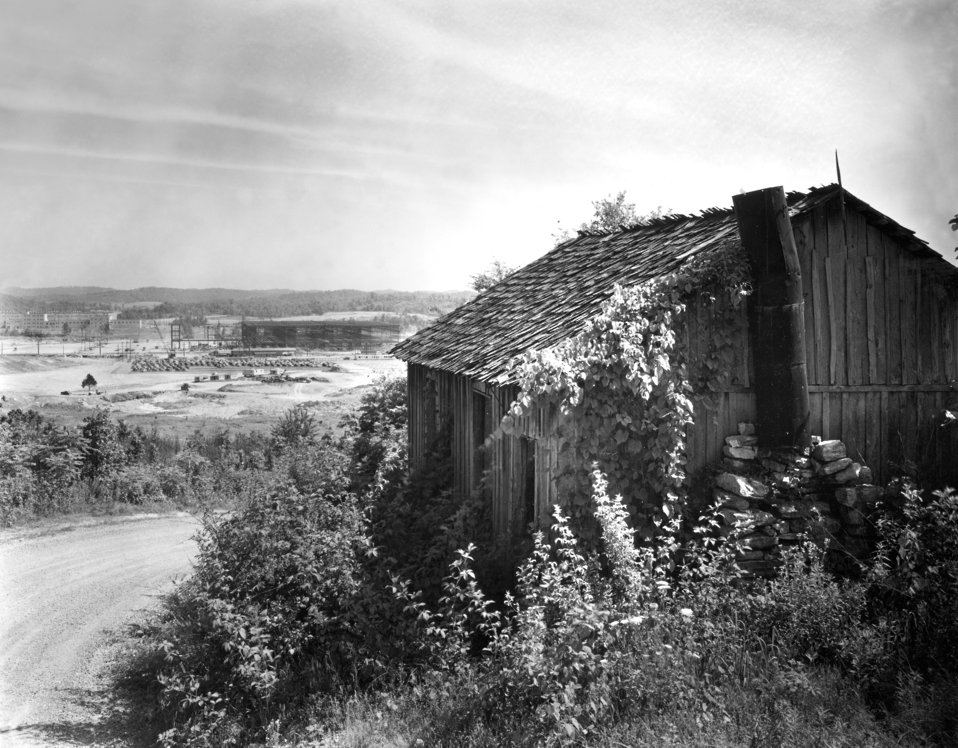 Early Construction K-25 plant with one of original houses Oak Ridge