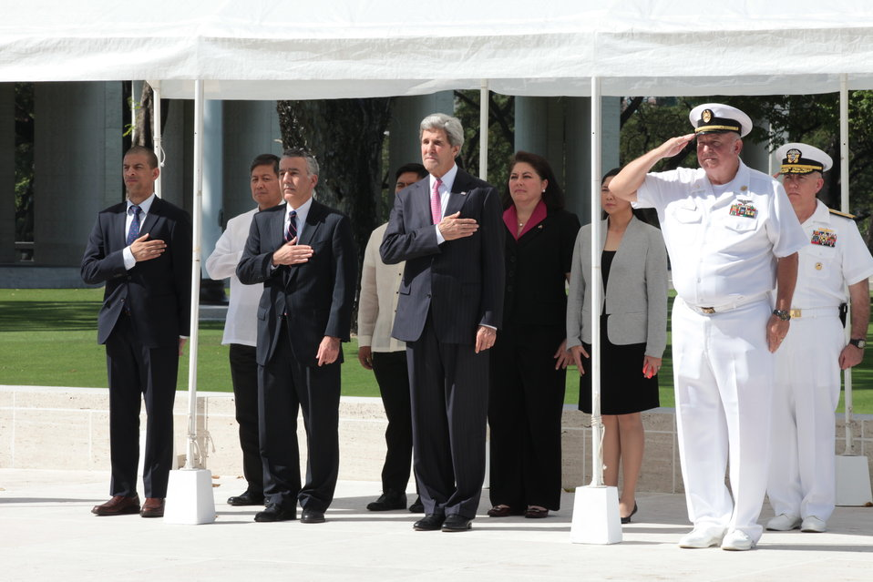 Secretary Kerry Pauses for the National Anthems at the American Cemetery in Manila